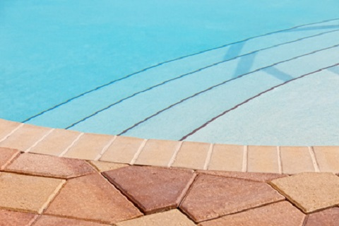 swimming pool deck with entry steps
