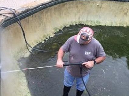 image of pressure washing swimming pool